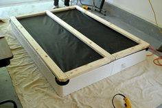"""Support your box springs with 2' x 4"""" frame, add legs, upholster the box springs and your bed is ready to go."""