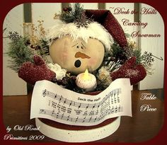 """Deck the Halls Caroling Snowman Table Piece... snowman sitting in a Christmas box, 10"""" tall"""