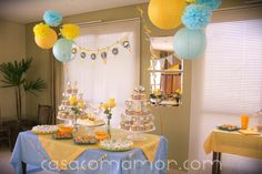 love the pom pom balls and paper lanterns