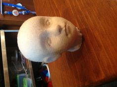 Molded felt doll head. Stretched the felt over a paper mâché head form I had cast from a mold I had made.
