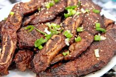 "Here's a little lesson on a delicious and affordable meat option.  Short ribs are well known in the Korean community, and these are a take off the Kalbi-style. The cut, known as ""flanken,"" which refers to a strip of beef cut across the bone from the chuck end of the short ribs. The result is a thin strip of meat, about 8-10 inches in length. The thin slices make for a quick cooking time on the grill."