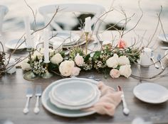 beach wedding tablescape with blush flowers and napkins
