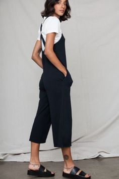 This apron front, cropped jumpsuit is made to be worn all the time, anywhere and everywhere. Details: 94% organic cotton. 6% spandex. Fitted. Size up for a roomier fit. Back Beat Rags is a 100% Califo