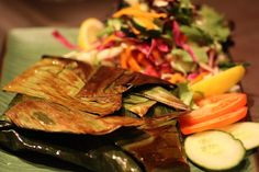 Meen Pollichathu- Pomfret or Red snapper marinated in special masala ,wrapped and baked in banana leaf. Red Snapper, India Food, Indian Food Recipes, Menu, Banana, Restaurant, Menu Board Design, Diner Restaurant, Indian Dishes