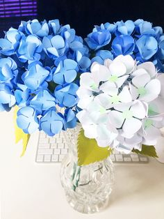 Hydrangeas are one of my favorite flowers with their high petal counts and  large scalloped leaves. Used as fillers or as centerpieces, they are  eye-catching and beautiful. These hydrangeas are created with paper and may  be used year round in your home or to gift to a loved one - they are bound  to impress. These flowers are by no means easy to make, but they are well  worth your labor. Create your own following the steps below!  Here's what you need:      * cardstock in your choice of…