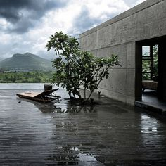 Khopoli House by Spasm Design Architects | Local basalt stone mixed into the concrete helps to connect it with its mountainous site. Check out more photos.