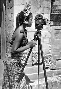 Girl studying how to take photographs in Bali, Indonesia, 1934
