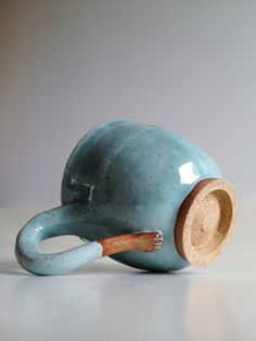 Ceramic cup with sculpted little foot handle by Natalie Strachan Ceramics - £12.00  nice idea, chicken foot it?