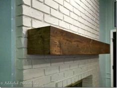 Rustic reclaimed wood mantel. This only looks old. Here's a DIY project that can cover an existing, ugly fireplace mantel with distressed wood.