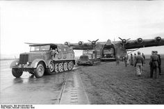 Me 323 D-1 Gigant unloading an Sd.Kfz. 8 and Praga T9, Tunisia, January 1943