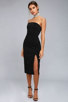 Keep things classy and classic with the Finders Keepers Lucie Black Strapless Midi Dress! Thick, woven fabric forms this structured dress with a strapless, princess seamed bodice (with no-slip strips and hidden boning) that extends into a figure-flaunting midi skirt with side slit. Exposed black zipper and hidden button closure at back.