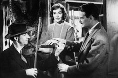 Jane Wyman and Lew Ayres in Johnny Belinda, In this scene Dr. Richardson is with Belinda who is deaf and mute. He places her hand on a fiddle so she can feel the vibration. 1940s Movies, Vintage Movies, Turner Classic Movies, Classic Films, Nine Movie, Lew Ayres, Jane Wyman, Cinema Film, Great Films