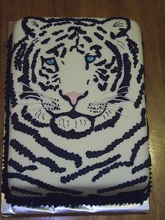 White tiger cake covered in fondant, black stripes done in butter cream.