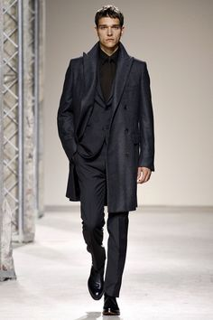 FALL 2013 MENSWEAR  Hermès /   Grilled on the thought processes that guide her so smoothly through the subtle but impressive evolution of Hermès menswear, Véronique Nichanian said she starts each season with colors. For Fall 2013, she's not alone in going dark, black and navy. Maybe it was the navy that triggered the collection's interest in coats. It's the shade of trenches and peacoats.