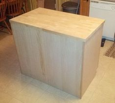"""A nice matching wood """"finishing"""" panel was then attached to the sides and back of the cabinets to match the front Kitchen Island Using Stock Cabinets, Kitchen Island Molding, How To Install Kitchen Island, Unfinished Kitchen Cabinets, Cabinet Island, Kitchen Island Table, Diy Kitchen Cabinets, Kitchen Ideas, Kitchen Islands"""
