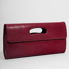 Vintage inspired ladylike clutch. Perfect match for dressy or casual attire.Double magnetic snap closureFully lined in fabric with Hobo signature credit card wall, bill pocket and zip security pocketBeautiful top-grain, vegetable-tanned leather with just a hint of shineBrushed Nickel Hardware12W x 6.5H x 1.75D