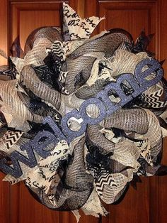 This is a Welcome Burlap Deco Mesh Wreath. It is made mainly from burlap and black deco mesh ribbon. It also contains regular burlap ribbon. It