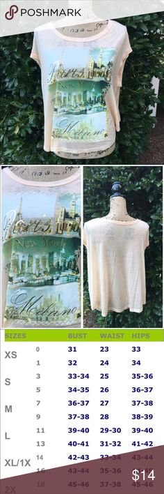 "City Name Graphic T-Shirt Graphic Tee with City Names London, New York, Paris & Milan *** Made in USA  🌺 Peach color, lightweight 100% Polyester knit 🌺 Pretty city landscape scenes on front of top 🌺 Relaxed fit, loose fitting, short sleeves and rounded neck 🌺Length:         Small: 23""         Medium: 23.5"" (shoulder to hem)         Large: 24"" ( shoulder to hem) Beach Wave Tops Tees - Short Sleeve"