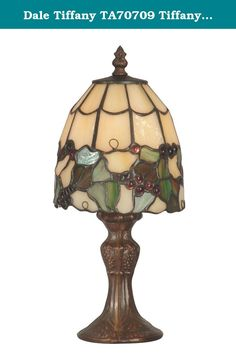 Dale Tiffany TA70709 Tiffany Grape Accent Lamp, Antique Brass and Art Glass Shade. Proof that good things do come in small packages, this little accent lamp will add a sunny touch of Tuscany to any room in your home. 84 pieces of art glass are hand rolled and copper foiled using the same technique Tiffany used over 150 years ago. Creamy, light amber provides a background for an abundant grapevine, complete with juicy art glass grapes. The metal base features a cast grape motif and is...