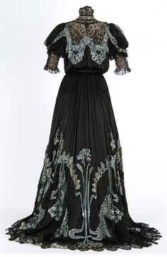 Black satin and lace gown with sequin and bead trim. Made by dressmaker Mary Molloy, Minneapolis, Minnesota. 1900-1909