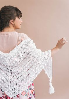 This adult sized crochet wrap can be worked up in a weekend and is so very easy! It only consists of creating a triangle shape and working in a 4 row repeat to enlarge the shape. It is a great project for those still somewhat new to the craft - perfect for someone who knows the basic stitches and wants to try something new. It is the perfect size and weight - not too chunky but soft, plush, and warm. It can be worn as a wrap around the shoulders or a triangle scarf around the neck.