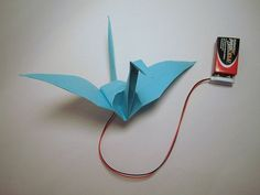 Electronic Origami Flapping Crane : Use shape memory alloy to make an origami crane that gently flaps its wings when you squeeze its tail : From High-Low Tech Stem Projects, Science Fair Projects, Science Experiments Kids, Science For Kids, Projects For Kids, Science Fun, Origami Tattoo, Origami Owl, Kids Origami