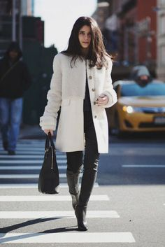 Opt for a long-line shearling coat and skinny jeans for a super-flattering silhouette.