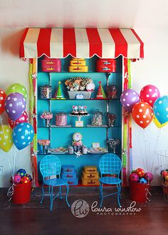 The baloons and striped canopy give me ideas for the head table/stage area...