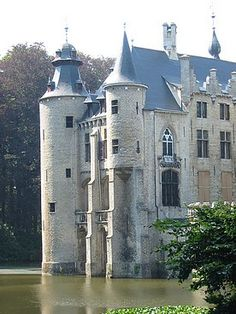 Borrekens Castle or Kasteel de Borrekens~was built around 1270 by a member of the Van Rotselaer family, stewards of the Dukes of Brabantia. They built this square water castle in a swampy area, close to the road of Antwerp-Turnhout, part of the trading route to Cologne, Germany, with whom Belgium had relations long since ancient times when Cologne was situated in Belgica. The castle is built from white Belgian Vilvoorde sandstone. It is located north-east of the town of Vorselaar.