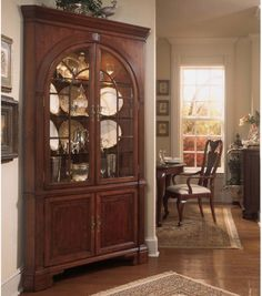 American Drew Cherry Grove Corner China Cabinet - Soften sharp angles while providing an elegant display with the American Drew Cherry Grove Corner China Cabinet. This stunning piece fits perfectly in...