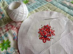 How to display tiny stitcheries in round or oval frames...and stitch this sweet little posy!