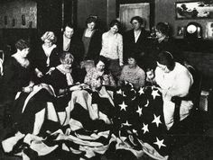 The Thimble Club of the Glendale Women's Auxiliary, Spanish American War Veterans Club repairing an American flag found by Frank Lawrence, Glendale Commander, when he fought in the Philippines. The event took place at a Betsy Ross Party at the home of Mrs. Catherine Litspreu in 1929. Glendale Central Public Library. San Fernando Valley History Digital Library.