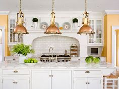 Simple Shaker-style doors, cup pulls classic white cabinetry and subway tiles, brass and copper lighting. - Traditional Home® White Subway Tile Backsplash, Kitchen Backsplash, Kitchen Countertops, Subway Tiles, Marble Countertops, Countertop Paint, Marble Worktops, White Counters, Kitchen Worktop