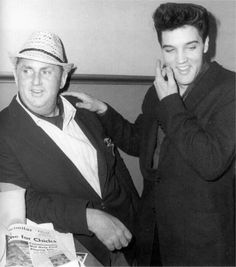 Tuesday morning, April 19, 1960; Elvis and the Colonel in Fort Worth, Texas during a quick layover at the Texas & Pacific Railway station; enroute to Hollywood.