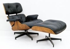 Lot 157-  Charles & Ray Eames Walnut Lounge Chair & Ottoman. Model 670 and 671 for Herman Miller. Original vintage armchair measures 33''x32''x30'' and matching ottoman 16.5''x26''x22''. Herman Miller label under chair. Slight wear to black leather.
