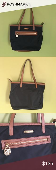 Michael Kors Kempton Small Tote Authentic Michael Kors small tote. Exterior is black nylon and brown leather trim. Never used, mint condition. Michael Kors Bags Shoulder Bags