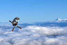 Adventure photographer Tyler Roemer has snapped pictures of rock climbing, white water rafting and hiking. But perhaps never anything as extreme as this.The Oregon photographer went up 11,000 with several professional skiers to capture incredible images of people skiing above the clouds. The skiers jumped off Mount Hood in Oregon and performed impressive aerial acrobatics with a mountain behind them and clouds beneath their feet.