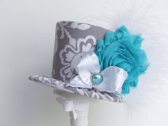 Mini Top Hat Headband, Alice in Wonderland themed Tea Party, SOMETHING BLUE,Birthday, Costume, Photo Prop, from Truly Sweet Circus. $22.95, via Etsy.