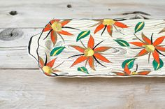A vintage French platter sports a vibrant floral pattern.