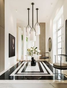 A black and white marble floor sets a dramatic tone in the foyer of Kelly Hoppen's London home. In these spaces, the most show-stopping design elements are beneath your feet. Home Design, Design Entrée, Flur Design, Deco Design, Paris Design, Design Ideas, Lobby Design, Design Trends, Design Projects