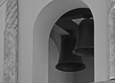 A photograph of two large bells in a bell tower in black and white. To purchase please go to http://memoriesoflove.imagekind.com