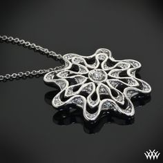 """This """"Embrace"""" Diamond Pendant is set in 18k White Gold and holds nearly 0.40ctw A CUT ABOVE® Hearts and Arrows Diamond Melee! This is the perfect addition for any jewelry lover!"""