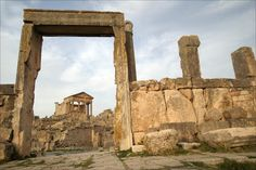 """""""Located in northern Tunisia, Dougga is sometimes called """"the best-preserved Roman small town in North Africa"""". Amongst the most famous monuments at the site are a Punic-Libyan mausoleum, the theatre and the capitol. The capitol is a Roman temple from the 2nd century CE, principally dedicated to the three most important Roman gods: Jupiter, Juno and Minerva."""" http://www.touropia.com/ancient-roman-temples/"""