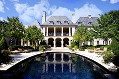 I love and WANT the back facade to look like this house.  2 story, covered terrace with archways and upper balcony with columns and iron railing and french style windows above  Fusch Architects   Architects & Planners » French