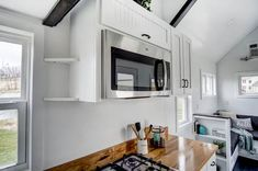 This is the Domino Tiny House on Wheels by Modern Tiny Living out of Columbus, Ohio and you're welcome to come check it out and take the full tour inside! Tiny House Trailer, Tiny House Plans, Tiny House On Wheels, Tiny House Bedroom, Tiny House Living, Living Room, Small Loft Apartments, Acacia Hardwood Flooring, Tiny Mobile House