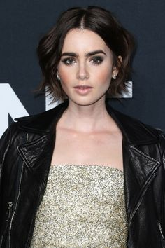 Looks like Lily's perfected the art of the tousled bob. Dark, dramatic makeup naturally goes hand-in-hand with her jet-black leather jacket.