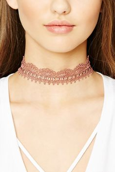 A choker featuring a crochet design and a lobster clasp closure.