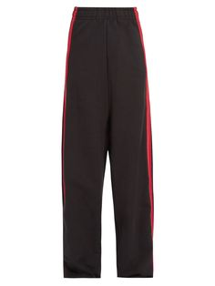 In typical Vetements style, Demma Gvasalia puts a directional twist on the classic track pant. This black French terry-towelling pair is cut to sit super-high on the waist before pooling to the floor in a billowing wide leg.