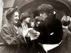 George signing autographs