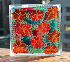 Jardín de clematis sol Catcher / rojo & naranja flores sobre